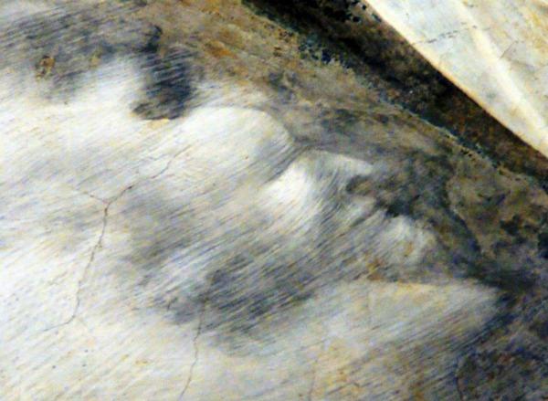 Un diavolo nascosto negli affreschi di Giotto.